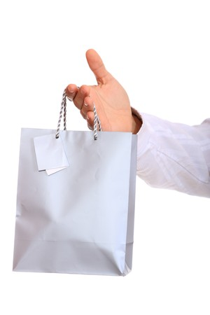 Hand with bag, isolated on white background  photo