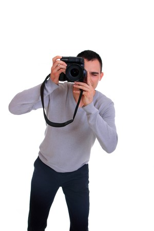 Portrait of male photographer with camera isolated on white background  photo