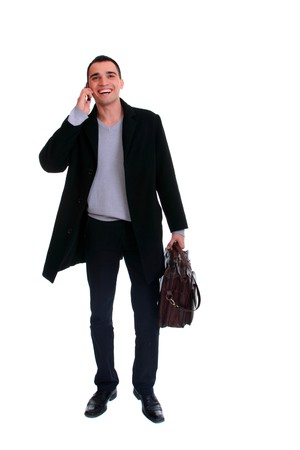 Portrait of a successful young business man on the phone carrying a suitcase on white background photo