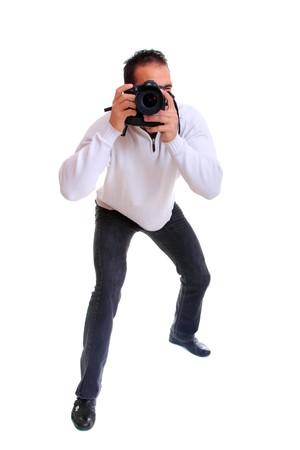 Portrait des männlichen Fotografen mit Kamera isoliert auf weißem Hintergrund  Standard-Bild