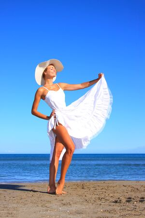 Young woman enjoying  the sea in Greece photo