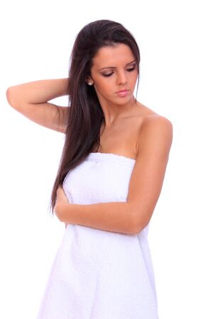 Portrait of a beautiful young woman in towels  isolated over white background Фото со стока