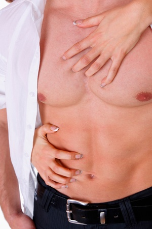 Woman's hands on a sexy muscle man's torso Stock Photo - 8720365