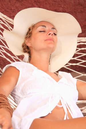 Woman sitting on sun bed in the summertime photo