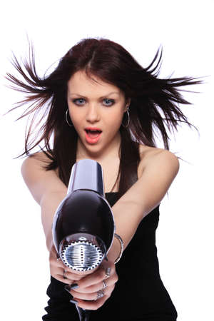 portrait of beautiful young woman with fashion hairstyle holding hairdryer  photo