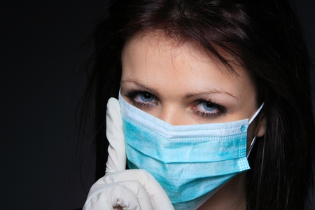 swine flu vaccination: Young nurse in mask