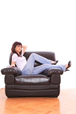 young brunette female on the couch at home photo