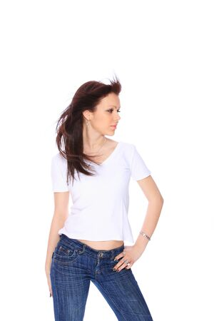 chearful: smiling young woman in jeans and t shirt, studioshot over white background Stock Photo