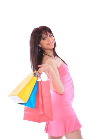 Trendy young girl with shopping bags on white background photo