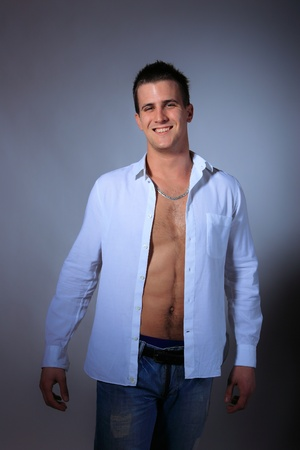 portrait of a young man with unbuttoned shirt Stock Photo - 9114821
