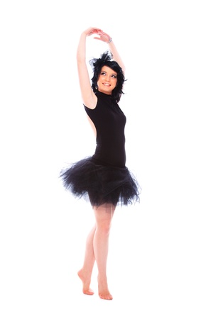 ballerina wearing black tutu posing on studio background photo