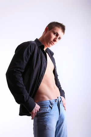 portrait of a young man with unbuttoned shirt photo