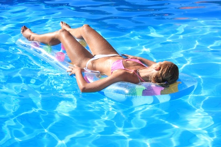 Young woman in the pool in greece Stock Photo - 9662385