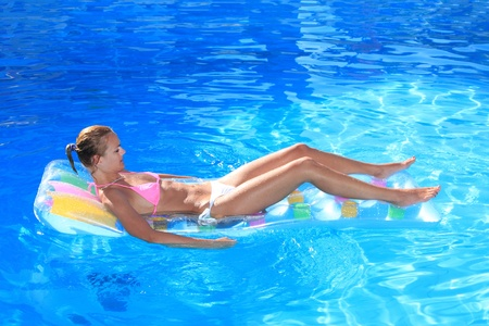 Young woman in the pool in greece Stock Photo