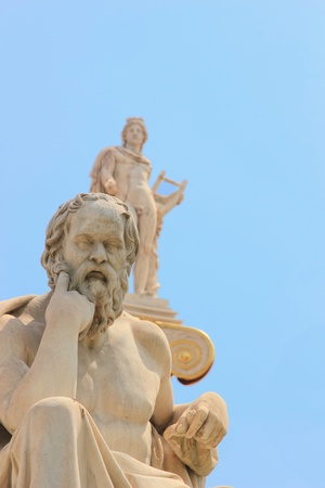 statue of Plato from the Academy of Athens,Greece with the statue of Athena on background photo