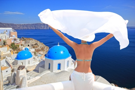 santorini: Young woman enjoying the view of  Santorini island Greece Stock Photo