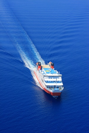 Aerial view of passenger ferry boat in open waters in Greece photo