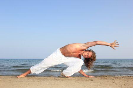 Capoeira  dancer on the beach photo