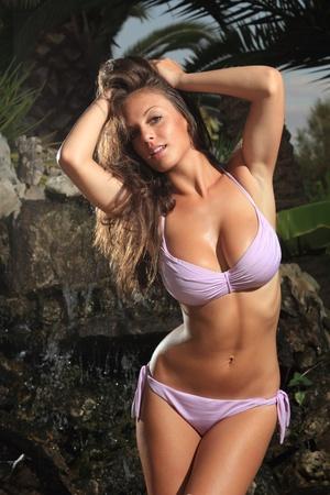 Sexy bikini model posing  in greece at dawn