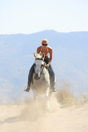 Young female rider on the beach photo