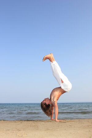Capoeira  dancer on the beach Stock Photo - 10913624