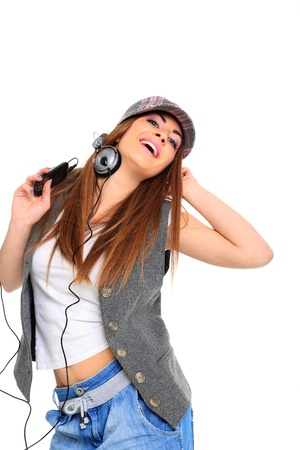 Cool teenager listening to music and dancing isolated on white background