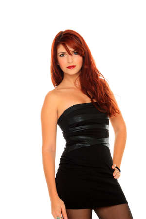 Portrait of a beautiful adult woman in black dress posing over white background photo