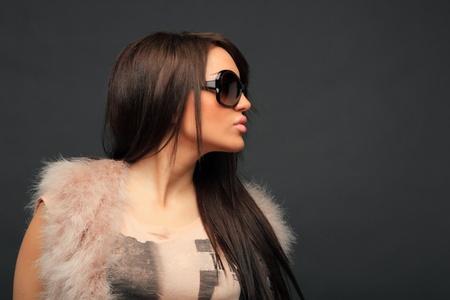 beautiful long hair brunette woman wearing sunglasses portrait, studio shot