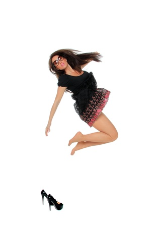 Portrait of a pretty young woman jumping in joy over white background Stock Photo - 12435104