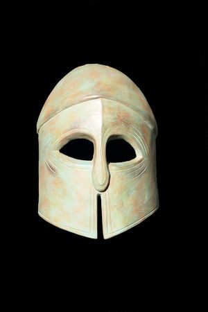 Ancient Greek Helmet over black background photo