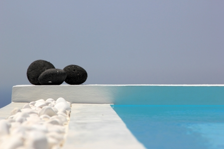 Swimming pool with stones set