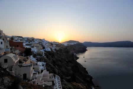 kyklades: Village of Oia at sunrise - Santorini island in the Cyclades, aegean sea, Greece Stock Photo