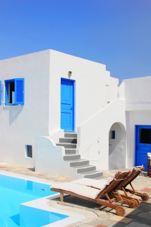 mediterranean houses: Classical Greek architecture of the streets in the Cyclades Greece Stock Photo