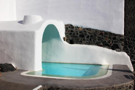 Swimming pool at Santorini island Greece Stock Photo - 15509957