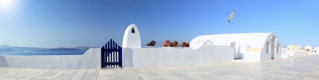 Panoramic view of a Classical Greek architecture of the streets in the Cyclades Greece