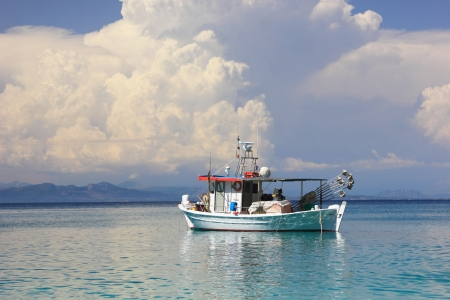 Fishing boat in the Ionian sea in Lefkada Greece photo