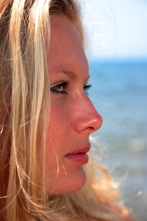 Young woman profile on a beach. photo
