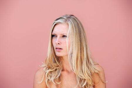 Beauty portrait of a blond woman over pink background Stock Photo - 15106383