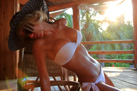 Young and sexy bikini model in tropical environment Stock Photo - 16591354