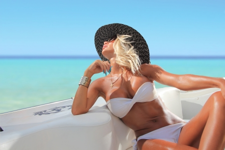 beautifull woman: Sexy woman with hat on a luxury yach Stock Photo