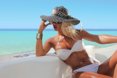 Sexy woman with hat on a luxury yach photo