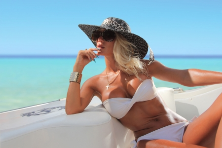 Sexy woman with hat on a luxury yach Stock Photo