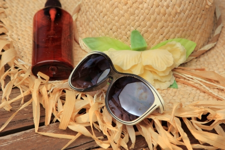 Straw Hat, Sun Glasses, Sun Block photo