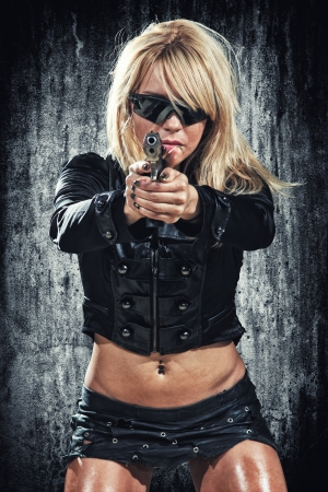 sexy woman holding up her weapon photo