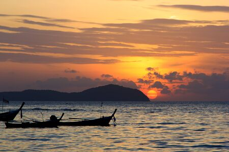 long tailed boat: Beautiful sunrise in Rawai Phuket island Thailand with Long tailed boat Ruea Hang Yao