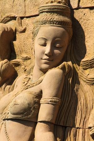 A Golden Kinnari statue Phuket Thailand photo