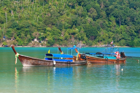 long tailed boat: Long tailed boat at beautiful bay of Koh Phi Phi island at day time, Thailand Stock Photo