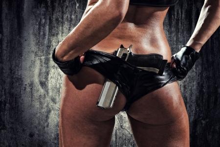 hardcore: sexy woman with hand gun