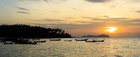 long tailed boat: Beautiful sunrise in Rawai Phuket island Thailand with Long tailed boat Ruea Hang Yao