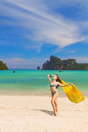 Young woman with sarong on Phi Phi beach Thailand photo